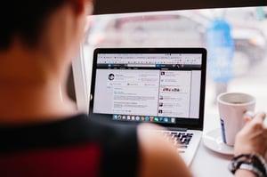 Over the shoulder shot of Katie Felten leveraging LinkedIn for business development